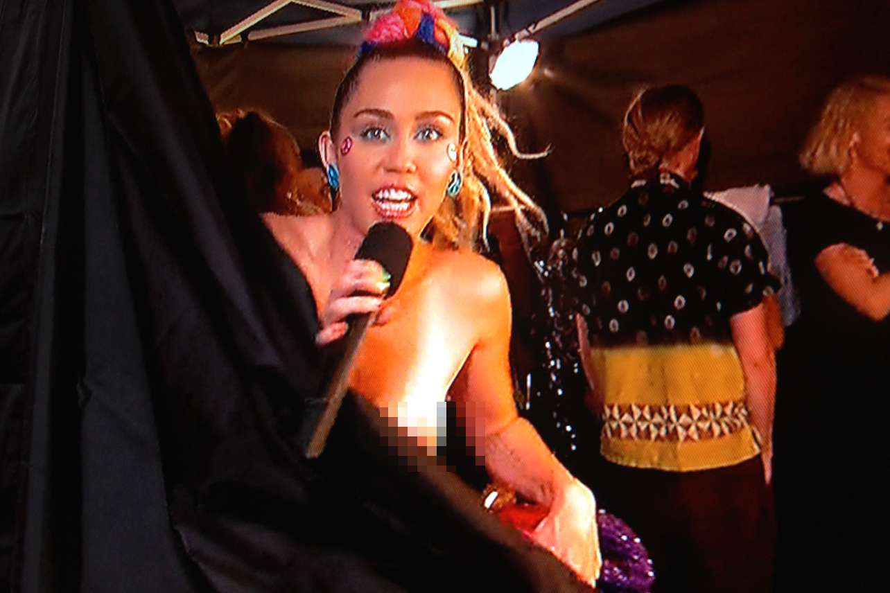 Miley cyrus boobs almost exposed